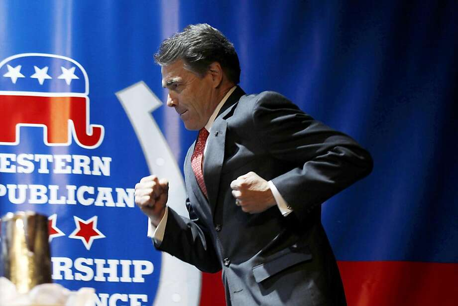 Republican presidential candidate, Texas Gov. Rick Perry, runs prior to delivering a keynote address during the Western Republican Leadership Conference, Wednesday, Oct. 19, 2011, in Las Vegas. (AP Photo/Isaac Brekken) Photo: Isaac Brekken, AP
