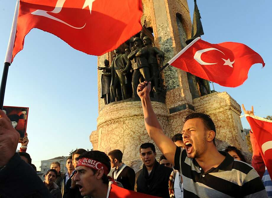 Demonstrators shout slogans on October 19, 2011 during a protest in the center of Istanbul against an attack earlier in the day against the Turkish military. Kurdish rebels killed 24 soldiers on October 19 in simultaneous attacks in southeast Turkey, marking one of the deadliest days for the army in the 27-year battle against the separatists. The Turkish military retaliated with air strikes and by sending in troops into neighbouring Iraq where the rebels are based while the prime minister cancelled a foreign trip. AFP PHOTO/BULENT KILIC (Photo credit should read BULENT KILIC/AFP/Getty Images) Photo: Bulent Kilic, AFP/Getty Images