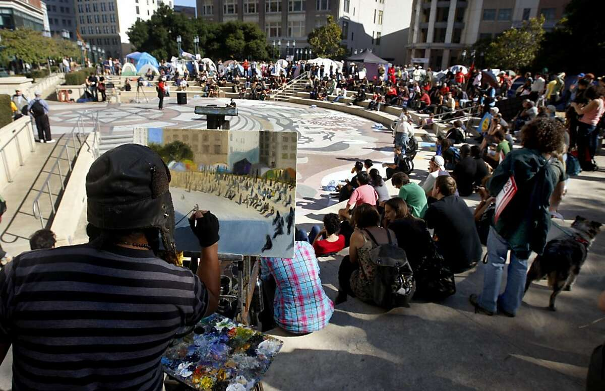 Plein air artist John Paul Marcelo paints a scene of the Occupy Oakland rally at Frank Ogawa Plaza in Oakland, Calif. on Saturday, Oct. 22, 2011. The city of Oakland has issued an eviction notice to campers in the tent city citing deteriorating conditions and health concerns.