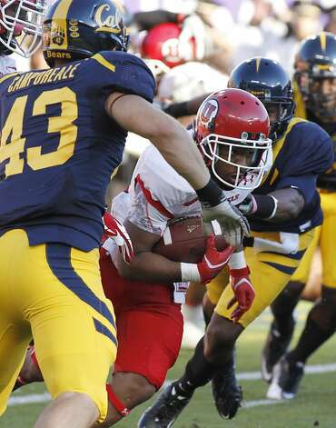 Utah's John White runs during the first half of an NCAA college football game against California, Saturday, Oct. 22, 2011 in San Francisco. California's Dan Camporeale (43) is in front. (AP Photo/George Nikitin) Photo: George Nikitin, AP