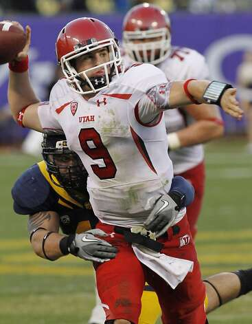 Utah quarterback Jon Hays throws under pressure from a California player during the second half of an NCAA college football game, Saturday, Oct. 22, 2011 in San Francisco. Hays' throw was intercepted by California. (AP Photo/George Nikitin) Photo: George Nikitin, AP