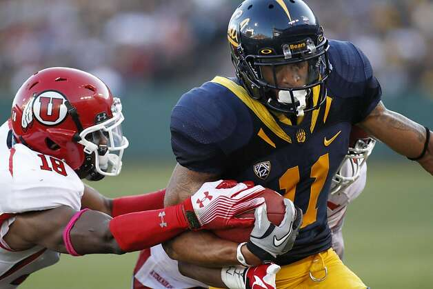 California's Michael Calvin, right, runs with the ball as Utah's Eric Rowe reaches for him and the ball during the first half of an NCAA college football game, Saturday, Oct. 22, 2011, in San Francisco. (AP Photo/George Nikitin) Photo: George Nikitin, AP