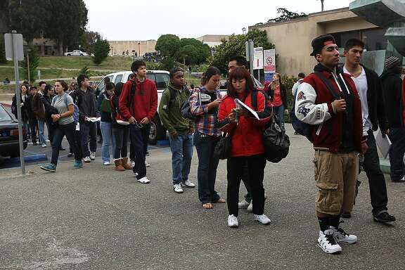 David Reyes (front, left), 18 years old, in front of the line at the bookstore at City College of San Francisco in Calif., on Monday, August 22, 2011.  A marketing and business sophomore who spent his freshman year at San Francisco State University, he found he could transfer his needed classes from CCSF for his second year.