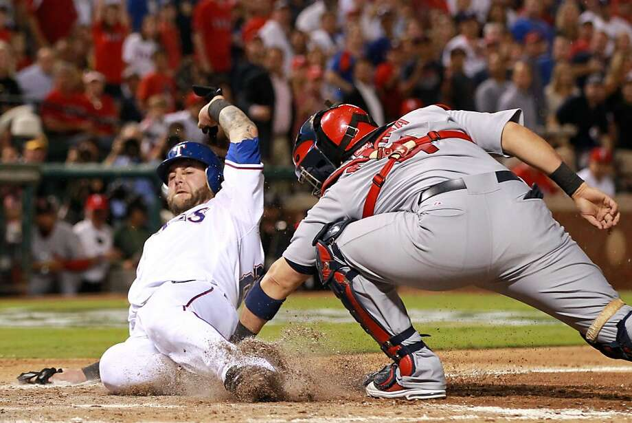 ARLINGTON, TX - OCTOBER 22:  Mike Napoli #25 of the Texas Rangers is tagged out at home plate by Yadier Molina #4 of the St. Louis Cardinals in the fourth inning during Game Three of the MLB World Series at Rangers Ballpark in Arlington on October 22, 2011 in Arlington, Texas.  (Photo by Ronald Martinez/Getty Images) Photo: Ronald Martinez, Getty Images