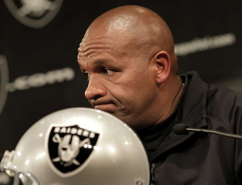 Raiders head coach Hue Jackson listened to his new quarterback answer a question. Oakland Raiders head coach Hue Jackson introduced his new quarterback Carson Palmer at a press conference at the club headquarters in Alameda, Calif. Tuesday October 18, 2011. Photo: Brant Ward, The Chronicle
