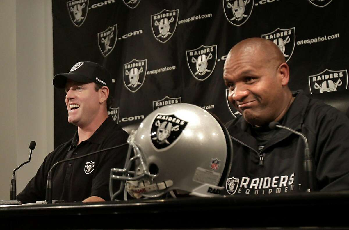 New quarterback Carson Palmer (left) and head coach Hue Jackson ended the press conference on a light note. Oakland Raiders head coach Hue Jackson introduced his new quarterback Carson Palmer at a press conference at the club headquarters in Alameda, Calif. Tuesday October 18, 2011.