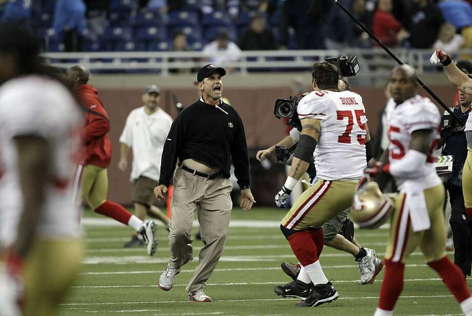 San Francisco 49ers head coach Jim Harbaugh and offensive tackle Alex Boone (75) celebrate their 25-19 win over the Detroit Lions after an NFL football game in Detroit, Sunday, Oct. 16, 2011. (AP Photo/Carlos Osorio) Photo: Carlos Osorio, AP