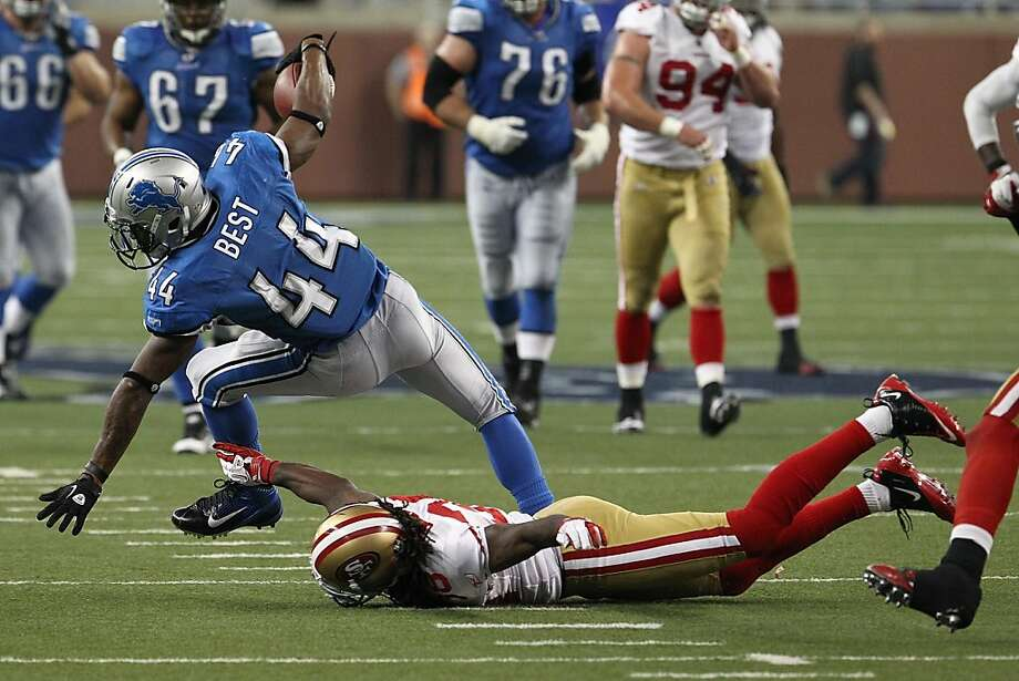 DETROIT, MI - OCTOBER 16:  Jahvid Best #44 of the Detroit Lions is triped up by Dashon Goldson #38 of the San Francisco 49ers during a NFL game at Ford Field on October 16, 2011 in Detroit, Michigan. The 49ers won 29-15  (Photo by Dave Reginek/Getty Images) Photo: Dave Reginek, Getty Images