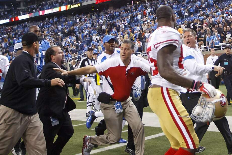 San Francisco 49ers head coach Jim Harbaugh, left, and Detroit Lions head coach Jim Schwartz, right, shout at each other after an NFL football game in Detroit, Sunday, Oct. 16, 2011. The 49ers won 25-19. (AP Photo/Rick Osentoski) Photo: Rick Osentoski, AP