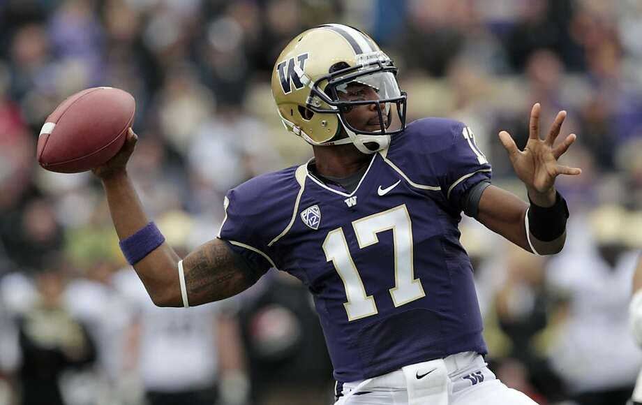 Washington quarterback Keith Price throws against Colorado on the first play in the first half of an NCAA college football game Saturday, Oct. 15, 2011, in Seattle. (AP Photo/Elaine Thompson) Photo: Elaine Thompson, AP