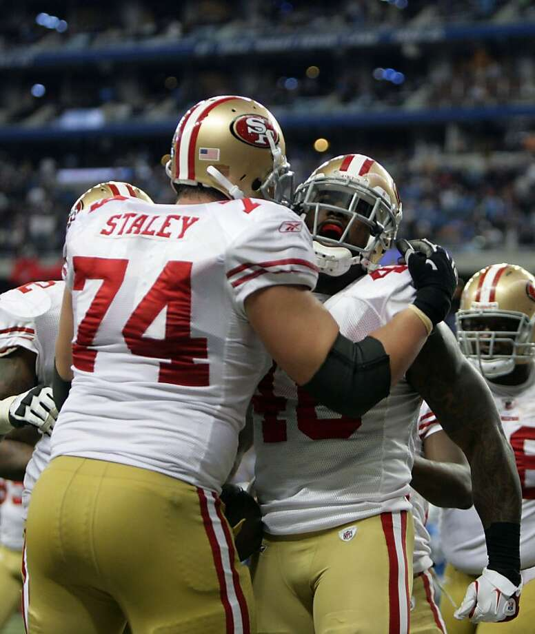 San Francisco 49ers Joe Staley celebrates with Delanie Walker, who scored during the fourth quarter against the Detroit Lions, Sunday, October 16, 2011 at Ford Field in Detroit, Michigan. The San Francisco 49ers defeated the Detroit Lions, 25-19. (Andre J. Jackson/Detroit Free Press/MCT)  Ran on: 10-17-2011 Joe Staley wasn't overly impressed with supposedly dominant Lions defensive tackle Ndamukong Suh. Ran on: 10-17-2011 Joe Staley wasn't overly impressed with supposedly dominant Lions defensive tackle Ndamukong Suh. Photo: Andre J. Jackson, MCT