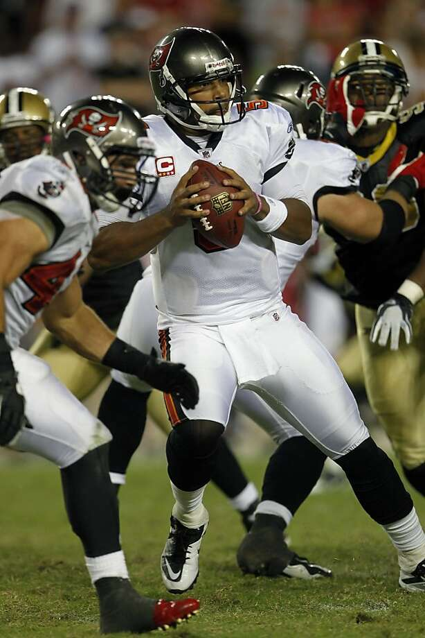 Tampa Bay Buccaneers quarterback Josh Freeman prepares to throw a pass during the fourth quarter of an NFL football game against the New Orleans Saints Sunday, Oct. 16, 2011, in Tampa, Fla. (AP Photo/Margaret Bowles) Photo: Margaret Bowles, AP