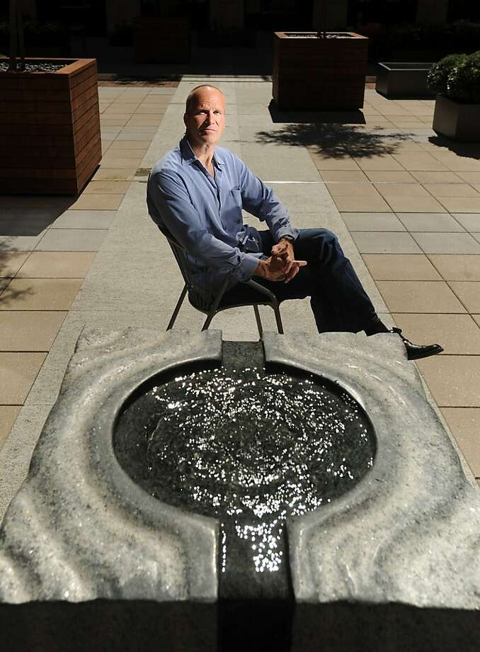 Sculptor Mark Mennin, who works in large granite objects, poses with a fountain he created for Stanford Law School's newest building on Monday, Sept. 26, 2011, in Stanford, Calif. Photo: Noah Berger, Special To The Chronicle