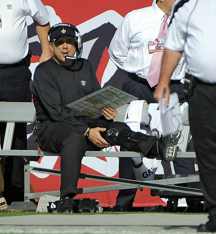 New Orleans Saints head coach Sean Payton, center, continues to coach from the bench after getting injured on a running play during the first quarter of an NFL football game against the Tampa Bay Buccaneers, Sunday, Oct. 16, 2011, in Tampa, Fla. (AP Photo/Brian Blanco) Photo: Brian Blanco, AP