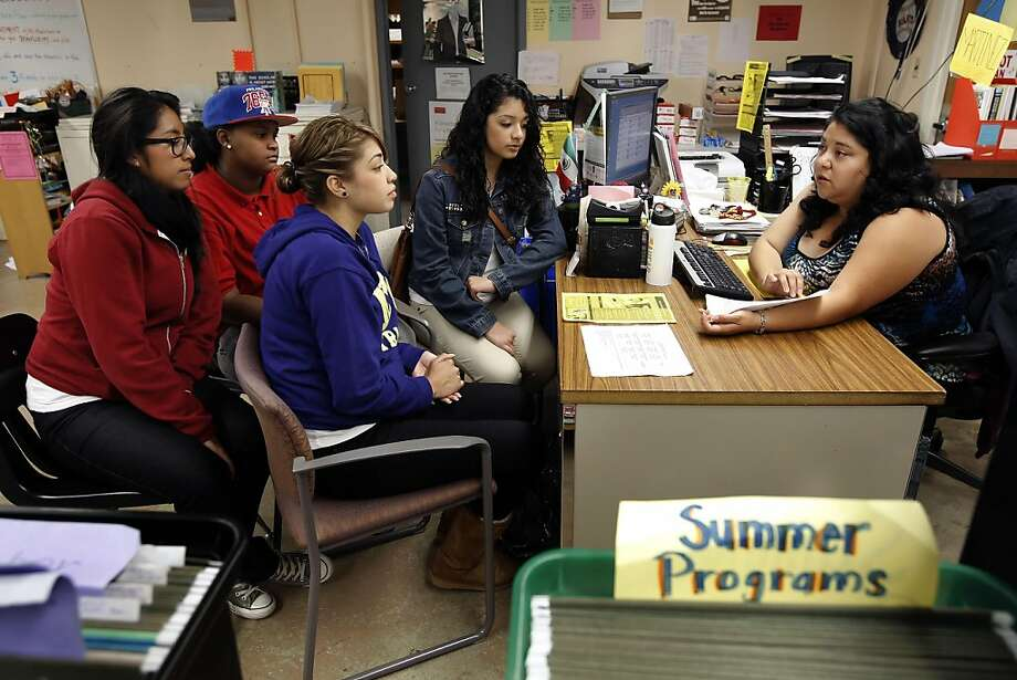 Vania Valle, Jessica Garrett, Kimberley Medrano and Andreana Kalaveras,  and , are all seniors at Lincoln High School in San Francisco, Ca. on Thursday Sept. 22, 2011, get a presentation from college and career counselor, Maria Martinez. The class of 2014 will be the first class in San Francisco that will be required to take and pass a college prep course load before they can receive their diploma. Photo: Michael Macor, The Chronicle