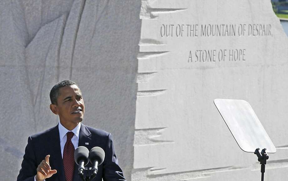 "The inscription ""Out of the Mountain of Despair, a Stone of Hope"" is seen as President Barack Obama speaks during the dedication of the Martin Luther King Jr. Memorial in Washington, Sunday, Oct. 16, 2011. (AP Photo/Charles Dharapak) Photo: Charles Dharapak, AP"