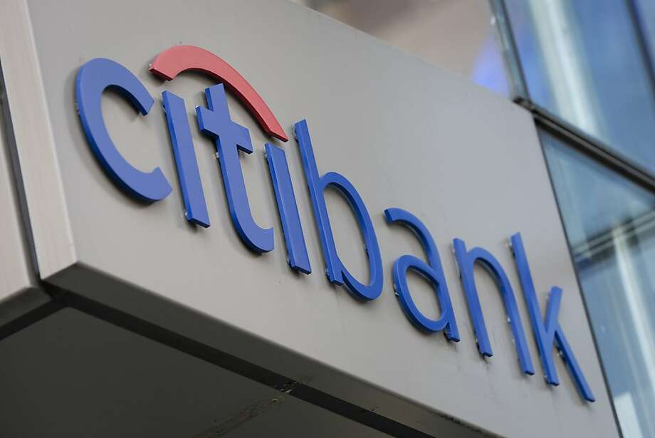 The Citigroup Inc. Citibank logo is displayed outside of a branch in New York, U.S., on Monday, Oct. 17, 2011. Citigroup, the third-biggest U.S. bank, said profit rose 74 percent, beating analysts' estimates as a $1.9 billion accounting gain reduced the impact of declining trading and investment-banking revenue. Photographer: Scott Eells/Bloomberg Photo: Scott Eells, Bloomberg