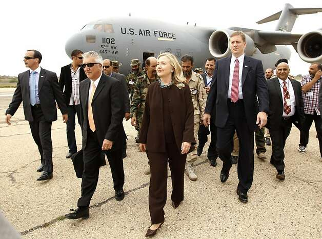 US Secretary of State Hillary Clinton walks from her C-17 military transport upon her arrival in Tripoli in Libya, October 18, 2011.  AFP PHOTO/POOL/Kevin Lamarque  (Photo credit should read KEVIN LAMARQUE/AFP/Getty Images) Photo: Kevin Lamarque, AFP/Getty Images