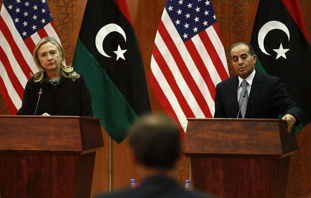 U.S. Secretary of State Hillary Clinton and Libya Transitional  National Council National Council Prime Minister Mahmud Jibril field a question during a joint press availability at the World Islamic Call Society Headquarters during Clinton's visit to Tripoli in  Libya on October 18, 2011.  AFP/KEVIN LAMARQUE/POOL (Photo credit should read KEVIN LAMARQUE/AFP/Getty Images) Photo: Kevin Lamarque, AFP/Getty Images