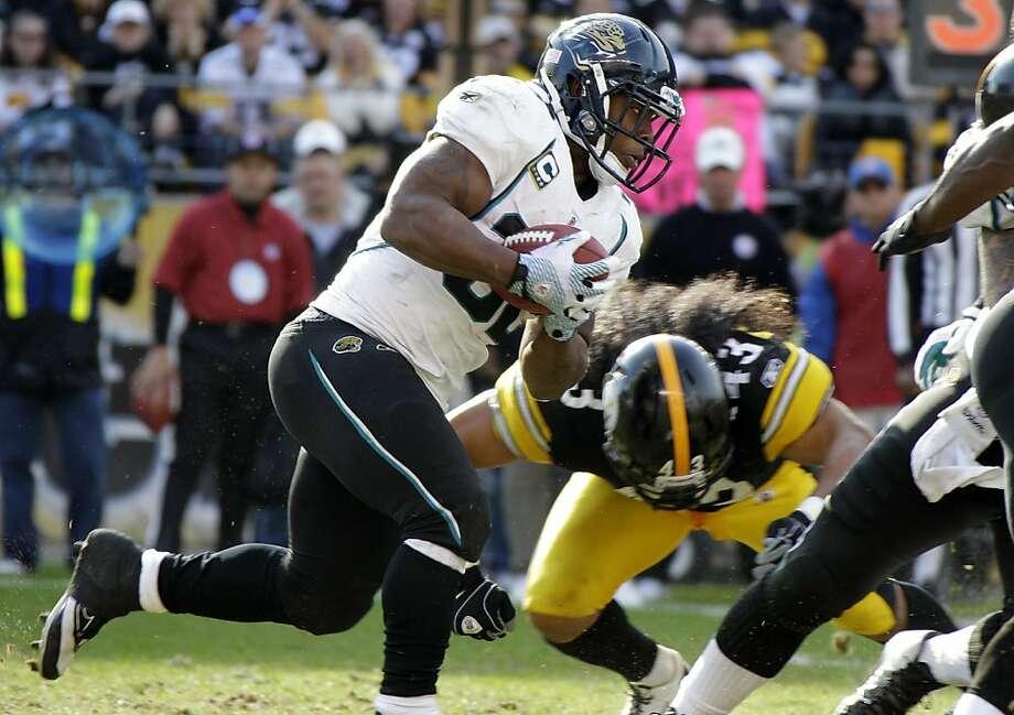 Jacksonville Jaguars running back Maurice Jones-Drew (32) is tackled by Pittsburgh Steelers' Troy Polamalu (43) during the fourth quarter of an NFL football game Sunday, Oct. 16, 2011, in Pittsburgh. The Steelers won 17-13. (AP Photo/Gene J. Puskar) Photo: Gene J. Puskar, AP