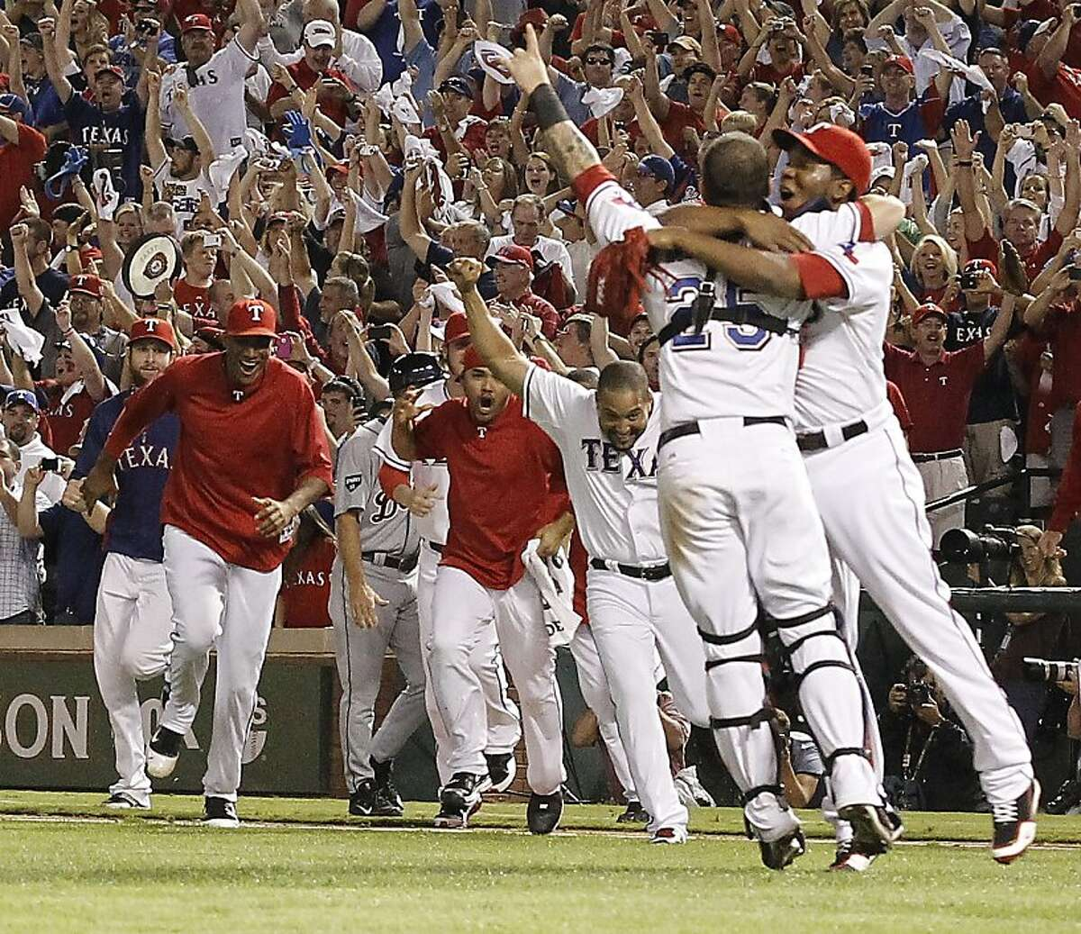 The Texas Rangers start the celebration after a convincing 15-5 win over the Detroit Tigers in Game 6 of the American League Championship Series in Arlington, Texas, Saturday, October 15, 2011. The triumph returns the Rangers to the World Series for the second year in a row. (Ron T. Ennis/Fort Worth Star-Telegram/MCT)