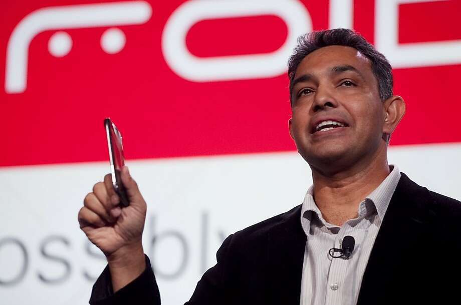 """Sanjay Jha, CEO of Motorola Mobility, holds the Droid Razr, Tuesday, Oct. 18, 2011 in New York. Seeking an edge in the world of high-end smartphones, Motorola is bringing back the """"Razr"""" name, once attached to the best-selling phone in the world. (AP Photo/Mark Lennihan) Photo: Mark Lennihan, AP"""