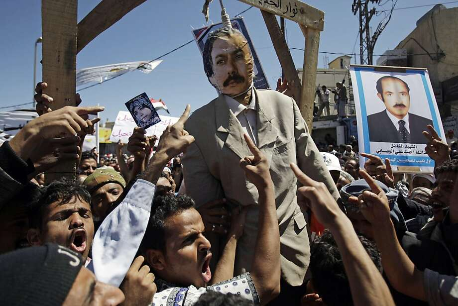 Anti-government protestors react and shout slogans with an effigy of Yemeni President Ali Abdullah Saleh hanging during a demonstration demanding his resignation in Sanaa, Yemen, Saturday, Oct. 15, 2011.(AP Photo/Hani Mohammed) Photo: Hani Mohammed, AP