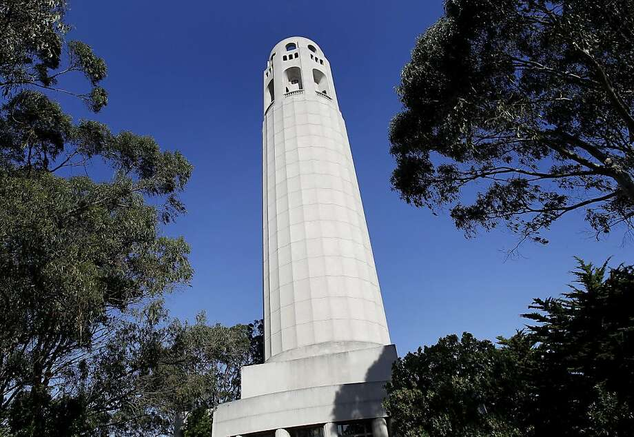 Coit Tower is striking against a blue October sky. The murals which adorn the inside of Coit Tower in San Francisco, Calif., which depict scenes of California labor and life during the Great Depression, have become scratched, faded and abused say tour guides. Photo: Brant Ward, The Chronicle