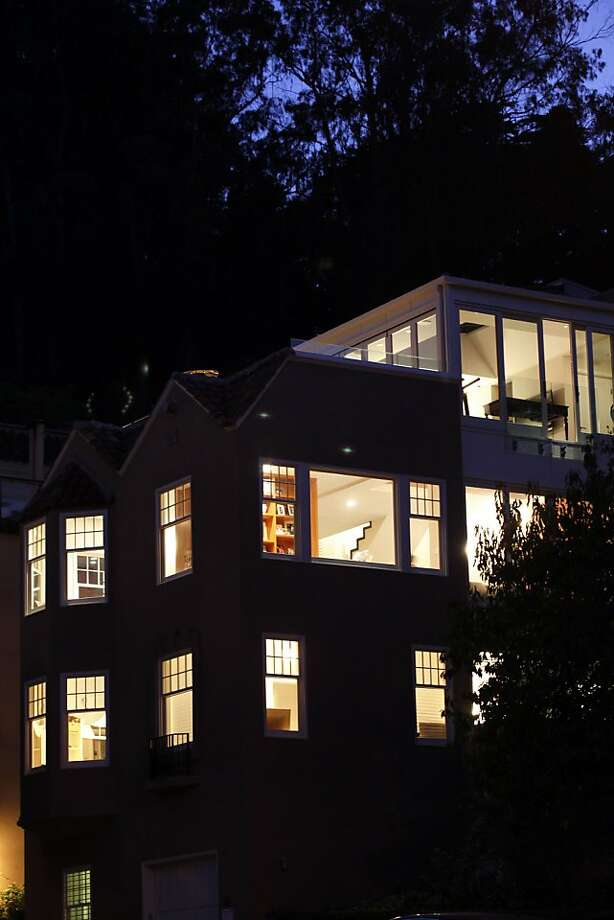 June Ou remodeled her home in a Historic District while creating a three-story glass wall to take advantage of northern view of Cow Hollow and Presidio in San Francisco, Calif., Tuesday, October 11, 2011. Photo: Sarah Rice, Special To The Chronicle