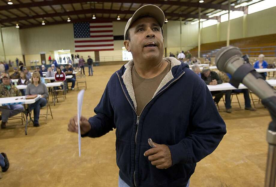 Migrant worker Fellipe Chacoa of Mexico talks about his desire to continue to harvest produce during a meeting of farmers and state officials to discuss the impact of the Alabama Immigration law on their livelihoods in Oneonta, Ala., Thursday, Oct. 20, 2011.  Chacoa said he had picked tomatoes for 26 years and that the new immigration law was scaring Hispanic workers into leaving the state to find work elsewhere. (AP Photo/Dave Martin) Photo: Dave Martin, AP