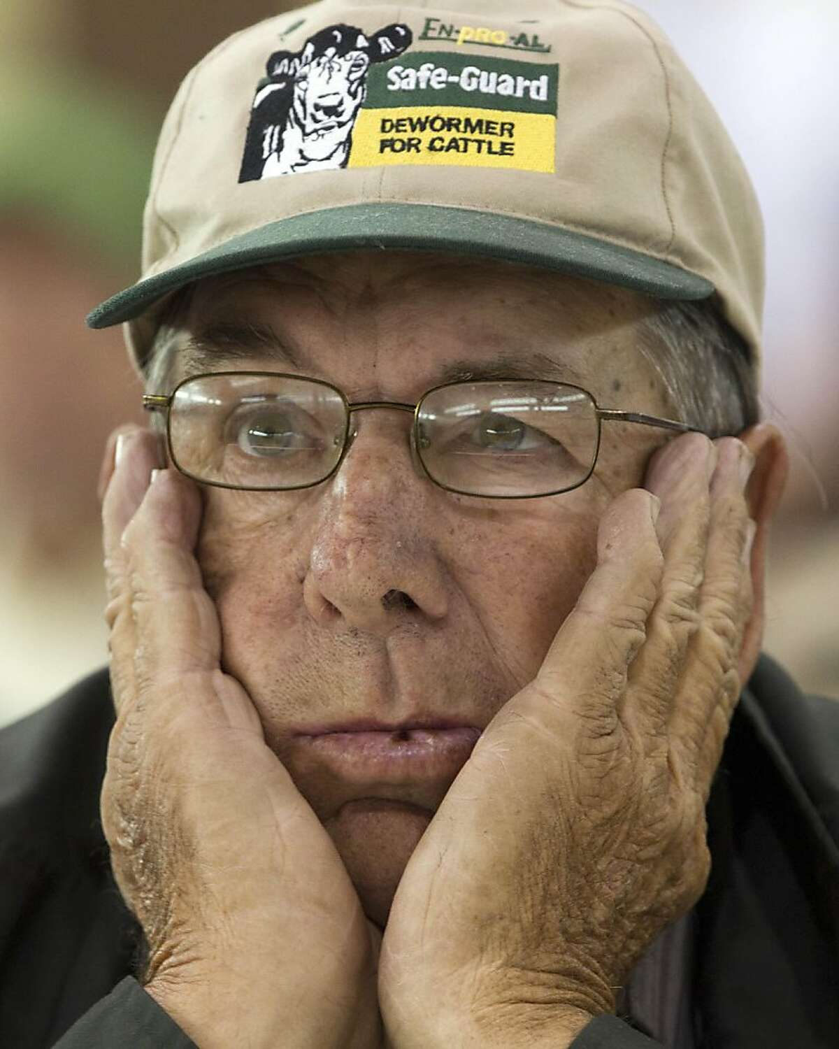 Produce farmer Jerry Marsh of Locust Fork, Ala., listens during a meeting of farmers and state officials to discuss the impact of the Alabama Immigration law on their livelihoods in Oneonta, Ala., Thursday, Oct. 20, 2011. (AP Photo/Dave Martin)