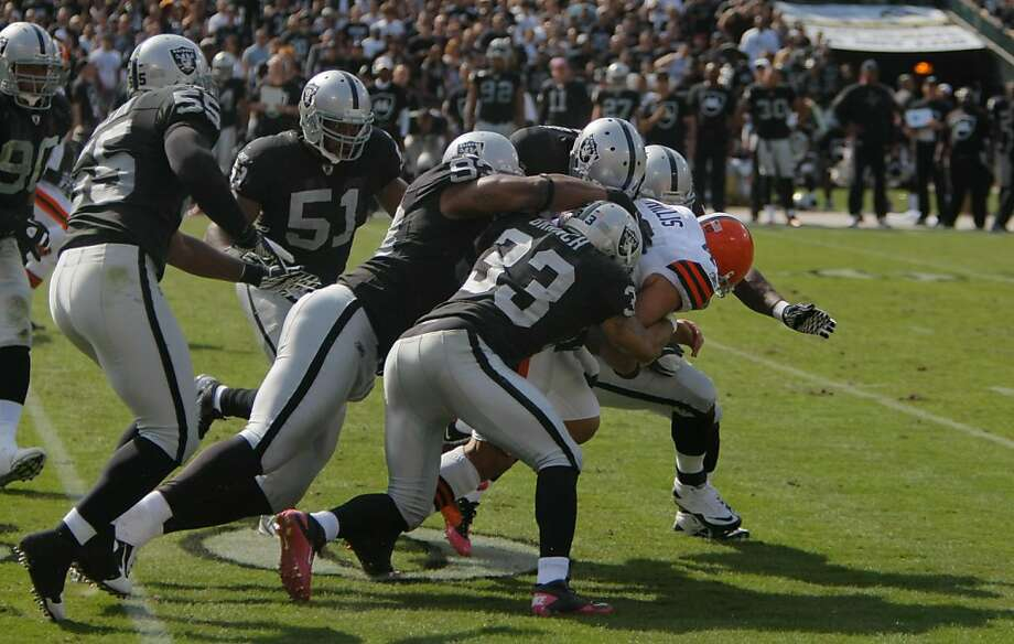 The Brown's Peyton Hillis is mobbed by the Raiders' defense at the O.co Coliseum in Oakland. Calif., on Sunday, Oct. 16, 2011. The Raiders would win the game, 24-17. Photo: Thomas Webb, The Chronicle