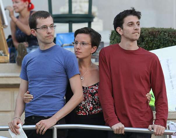 Shane Bauer (L), Sarah Shourd, and Josh Fattal attend the Occupy Oakland camp in Frank Ogawa Plaza, on Monday, Oct. 17, 2011, in Oakland, Calif. Photo: Mathew Sumner, Special To The Chronicle