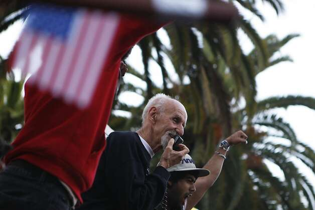 A man identified as Father Louie speaks to the Occupy SF protestors at Justin Hermann Plaza before a march to the Federal Reserve Building in San Francisco, Calif., on Monday, Oct. 17, 2011. Photo: Dylan Entelis, The Chronicle