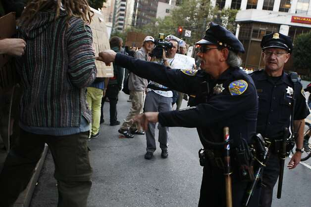 A police officer forcefully pushes protestor Daniel Kelley from the street in front of the Federal Reserve Building in San Francisco, Calif., on Monday, Oct. 17, 2011. Photo: Dylan Entelis, The Chronicle