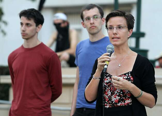 Sarah Shourd addresses the Occupy Oakland camp as Shane Bauer (center) and Josh Fattal listen in Frank Ogawa Plaza, on Monday, Oct. 17, 2011, in Oakland, Calif. Photo: Mathew Sumner, Special To The Chronicle
