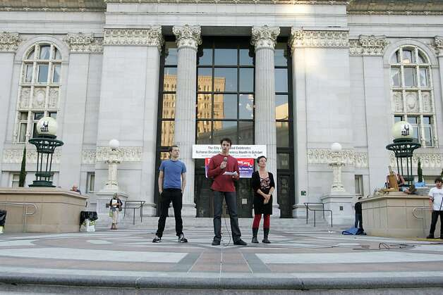 Josh Fattal addresses the Occupy Oakland camp as Shane Bauer and Sarah Shourd listen in Frank Ogawa Plaza, on Monday, Oct. 17, 2011, in Oakland, Calif. Photo: Mathew Sumner, Special To The Chronicle