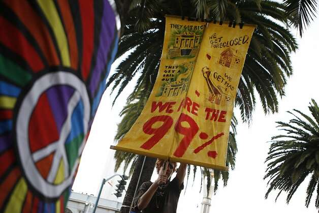 The Occupy SF protestors demonstrate at Justin Hermann Plaza and march to the Federal Reserve Building in San Francisco, Calif., on Monday, Oct. 17, 2011. Photo: Dylan Entelis, The Chronicle