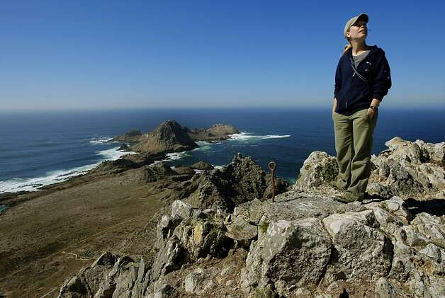 Megan Elrod,  with the Point Reyes Bird Observatory, atop the highest point of  south east Farallon Island off the coast of San Francisco, Ca., on Wednesday October 12, 2011. Efforts to control the non-native house mice problem in the Farallon Islands have failed. Officials say the mouse population has grown so large that they have altered the ecology of the island. Photo: Michael Macor, The Chronicle