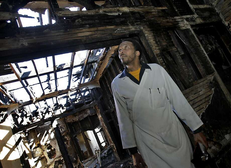 Pierre Pegeron walked through the top floor of the burned out building where he warned residents. Pierre Pegeron ran into a building across the street from his work on Haight Street in September after it caught fire.  He warned residents to get out and is credited with saving lives. Photo: Brant Ward, The Chronicle