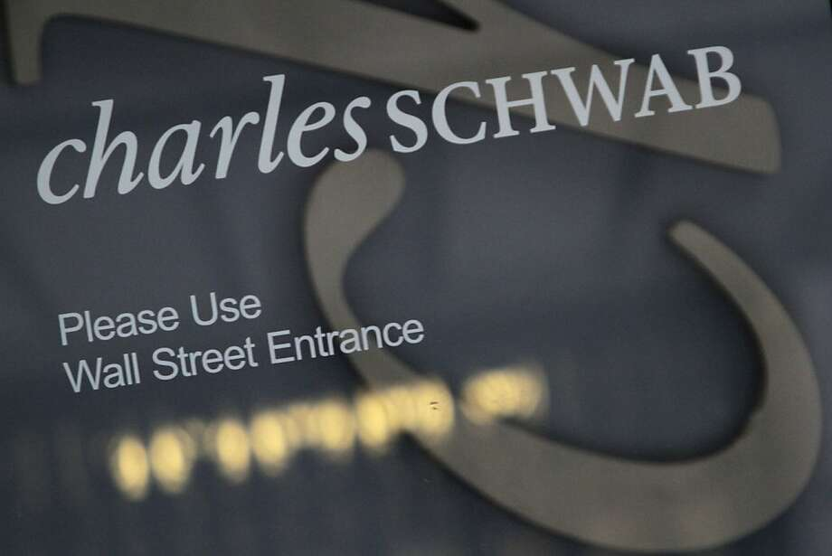 FILE - This Jan. 15, 2010 file photo, shows the logo on a Charles Schwab store on Wall Street, in New York. Discount broker Charles Schwab Corp. said Monday, Oct. 17, 2011, its third-quarter net income rose 77 percent as more investors turned to the company's advisory services amid increased market volatility and stock trading increased. (AP Photo/Mary Altaffer, File) Photo: Mary Altaffer, AP
