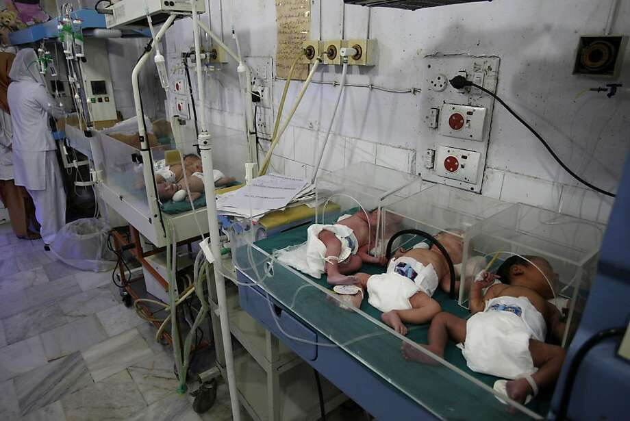 In this Oct. 12, 2011 photo, a nurse stands next to newly born babies sleeping under warmers at Lady Willingdon Hospital in Lahore, Pakistan. The government of Pakistan's most populous province, Punjab, turned down an American offer of $127 million for health care, education and municipal services following the U.S. raid that killed Osama bin Laden. Sixteen million dollars had been earmarked for the hospital. The impact of an aid cut in this poverty-stricken country would be felt most acutely by the poorest citizens. (AP Photo/K.M. Chaudary) Photo: K.M. Chaudary, AP