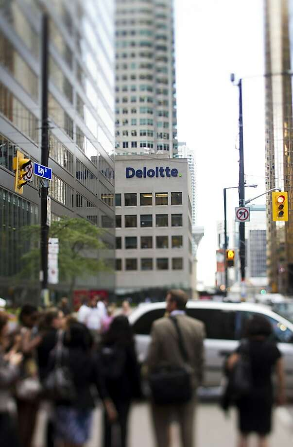 Pedestrians walk on Bay Street past the Deloitte LLP offices in this photo taken with a tilt-shift lens in Toronto, Ontario, Canada, on Monday, Aug. 29, 2011. Bay Street is the center of Toronto's Financial District and is often used as a metaphor to refer to Canada's financial industry. Photographer: Brent Lewin/Bloomberg Pedestrians walk on Bay Street past the Deloitte LLP offices in this photo taken with a tilt-shift lens in Toronto, Ontario, Canada, on Monday, Aug. 29, 2011. Bay Street is the center of Toronto's Financial District and is often used as a metaphor to refer to Canada's financial industry. Photographer: Brent Lewin/Bloomberg Photo: Brent Lewin, Bloomberg