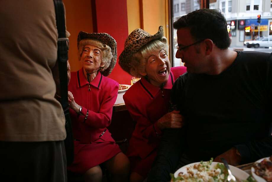 Sept. 22, 2008 7:12 p.m.:  The Brown twins, Marian and Vivian, hob knob with tourist during dinner at Uncle Vito's pizza parlor. --- the City Exposed  The Twins  A recent Monday 7:12 p.m.:   Parked in their usual window seat at Uncle Vito's, just below the crest of Nob Hill, the twins are barely through their first glass of merlot. One welcomes an adoring tourist from Phoenix while the other laughs encouragement into the ear of a businessman dining by himself. Marian and Vivian Brown are the twins famous for bringing San Francisco's quirky spirit to the world, via numerous TV and billboard appearances.  Don't ask their age, as they'll politely tell you it's none of your business -- though Vivian does admit she's 8 minutes older, saying this if only to remind Marian who's in charge. They argue this for a bit then break into one of their signature tunes I left my heart in San Francisco...and all is forgotten.  Photo: Mike Kepka, The Chronicle