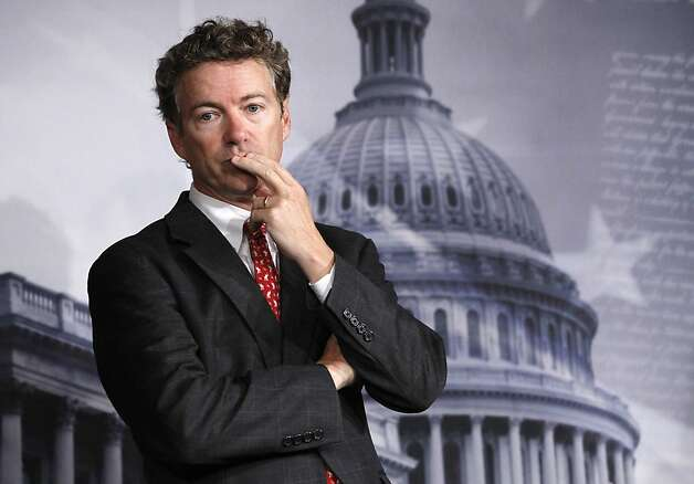 Sen. Rand Paul, R-Ky. listens to a question during a news conference on Capitol Hill in Washington Thursday Oct. 13, 2011, to discuss the introduction of a Republican alternative jobs bill.  (AP Photo/Manuel Balce Ceneta) Photo: Manuel Balce Ceneta, AP