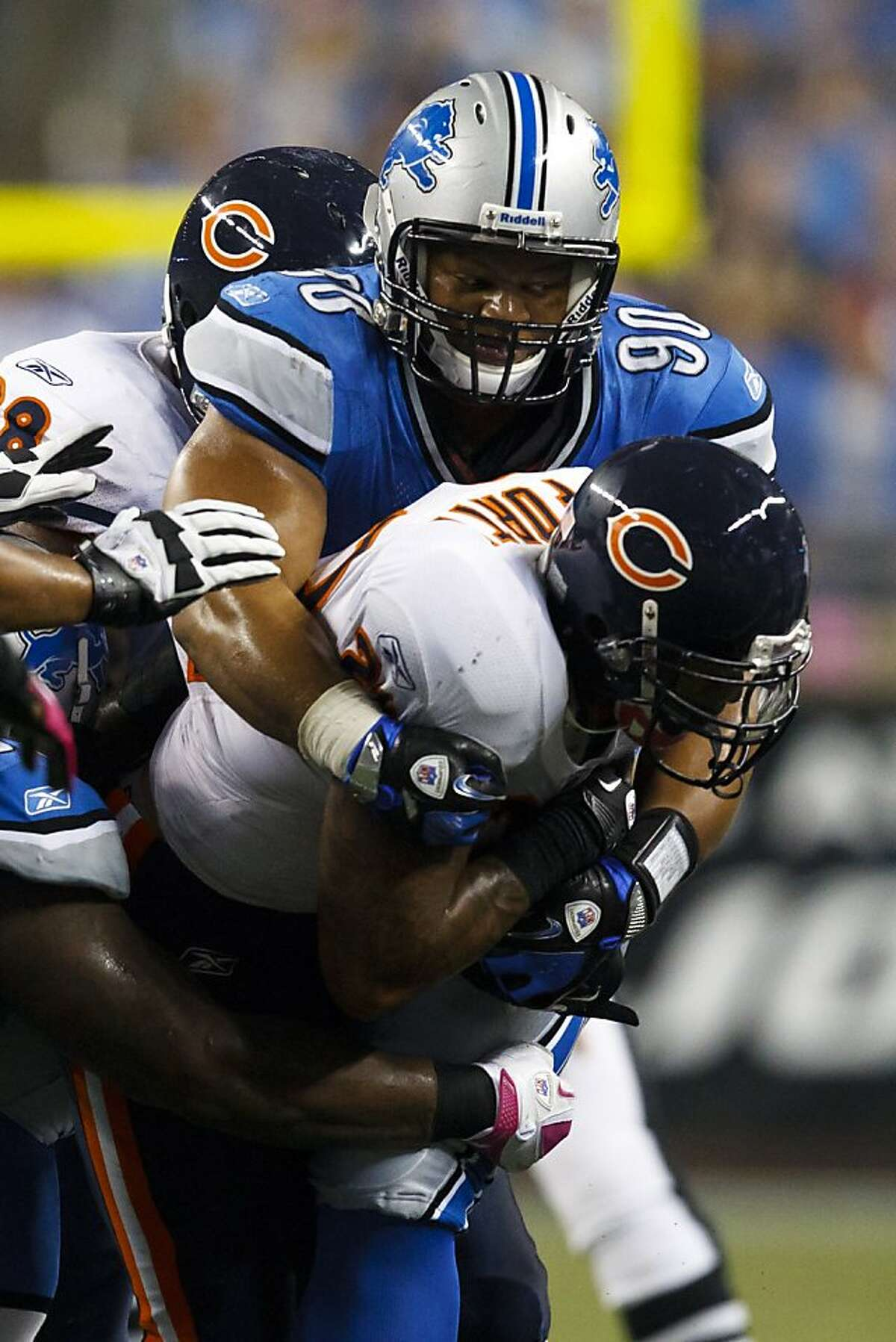Detroit Lions defensive tackle Ndamukong Suh (90) tackles Chicago Bears running back Matt Forte (22) in the first half of an NFL football game in Detroit, Monday, Oct. 10, 2011. (AP Photo/Rick Osentoski)
