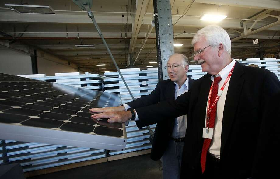 Secretary of the Interior Ken Salazar, left, and U.S. Congressman George Miller look at a solar panel display while touring the SunPower solar power research and development facility in Richmond, Calif., Thursday, Oct. 14, 2010. (AP Photo/Jeff Chiu) Photo: Jeff Chiu, ASSOCIATED PRESS