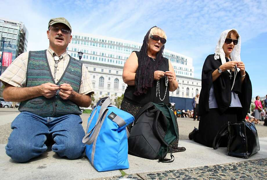 Catholics gathered in front of the Civic Center to celebrate the 50th Anniversary of the 1961 Rosary Crusade in San Francisco. Calif., on Saturday, Oct. 15, 2011.  Local members of the clergy led the crowd in a Rosary prayer.  Ran on: 10-16-2011 Catholics gather in front of the Civic Center to recite the rosary, marking the 50th anniversary of the rosary crusade. Photo: Thomas Webb, The Chronicle