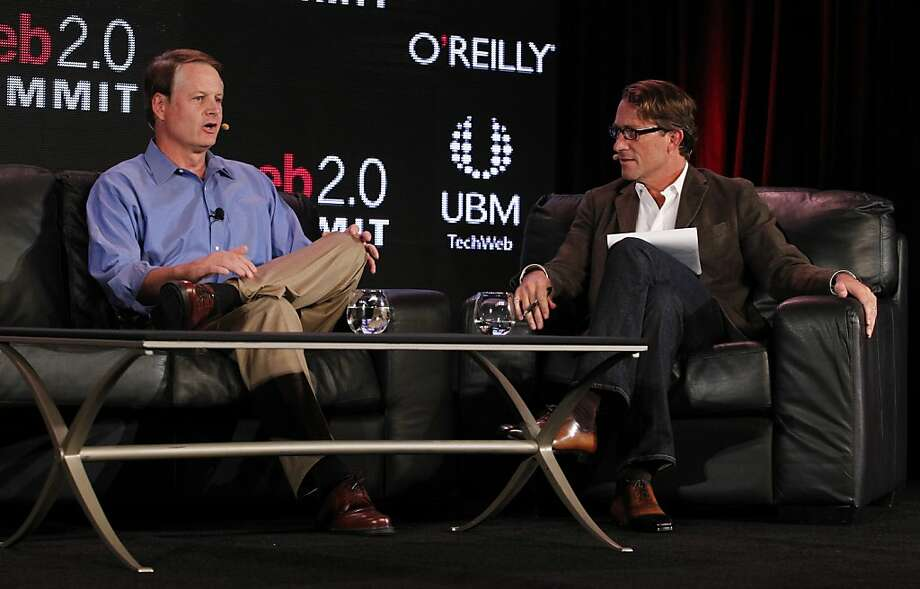 John Donahoe (left), of eBay, speaks with John Battelle, of Federated Media Publishing Inc., at the Web 2.0 Summit at the Palace Hotel  on Monday, October 17, 2011 in San Francisco, Calif. Photo: Beck Diefenbach, Special To The Chronicle