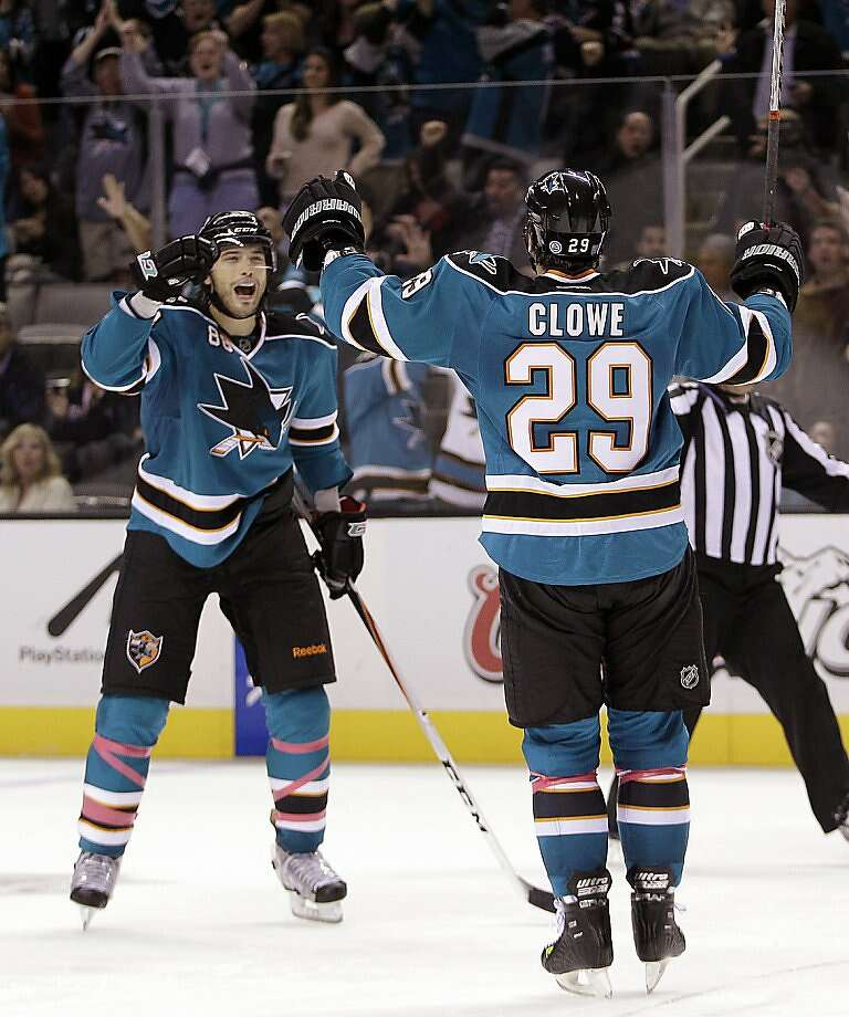 San Jose Sharks' Brent Burns, left, celebrates with teammate Ryane Clowe (29), who assisted on the goal, against the St. Louis Blues during the second period of an NHL hockey game Saturday, Oct. 15, 2011, in San Jose, Calif. (AP Photo/Ben Margot) Photo: Ben Margot, AP